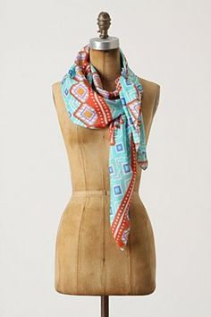 Bright scarf with ikat motifs perfect to pair with white boyfriend tee and gold sandals