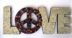 """Love Mosaic Mirror Wall Art Hanging with Peace Sign by Florida Gifts. $34.99. Designer Style. LOVE - Mosaic mirror wall hanging with peace sign. NEW. Approximately 19.75"""" wide and 7.75"""" tall. Wire hanger on back. LOVE. Mosaic mirror wall hanging with peace sign. Approximately 19.75"""" wide and 7.75"""" tall. wire hanger on back. New.. Save 19% Off!"""