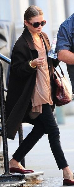 Picture of elegance: The former child star wore skinny black trousers paired with a dusty pink over-sized shirt and maroon patent flats