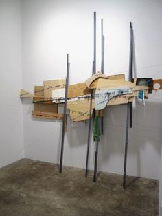Exactly what I'm interested in, the blending or blurring of lines betw. media: Elana Herzog, Untitled Bundle, 2012, wood, hardware, textile, metal staples, 92 x 14 x 13 inches.