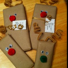 Candy bar reindeer! Decorated using googly eyes, puffs, pipe cleaners and brown craft paper! Super simple.