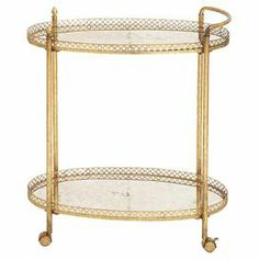"Glass-top tea cart in gold with 2 tiers with raised linked edges   Product: Tea cartConstruction Material: Glass and metalColor: GoldFeatures: Two tiersDimensions: 35"" H x 30"" W 16"" D"