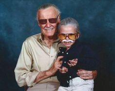 Little Girl Cosplaying as Stan Lee While Posing with Stan Lee