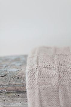 Knitted blanket. It's beauty lies in it's simplicity.