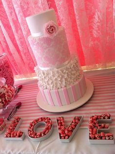 Four-tier cake with hydrangea ruffles, pink damask stencilling and a sugar peony by Cake It bakery