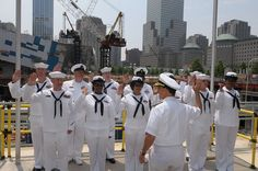 110526-N-PS473-081 NEW YORK, (May 26, 2011) -- Rear Adm. Herman Shelanski, Commander, Carrier Strike Group 10 re-enlists 12 Sailors at Ground Zero, May 26th, the ceremony was one of many events happening at this year's Fleet Week New York 2011