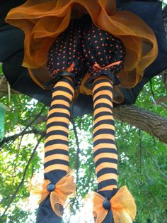Floating witch made from a dollar store umbrella - using pool noodles for legs. LOVE this!