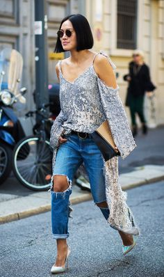 Sequin dress over distressed denim