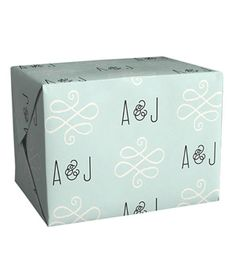 Alford Park Personalized Wrapping Paper: No need for a tag—recipients will know exactly who this gift is coming from after you wrap their gifts in these personalized sheets.