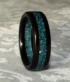 Custom Wooden and Corian Wedding Band for the groom $45.00, via Etsy.