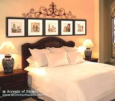 Love the pictures above the bed with the scroll-work