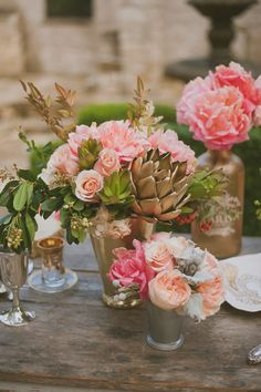 spray painted succulents to elevate a centerpiece, photo by Day 7 Photography http://ruffledblog.com/metallic-garden-wedding-inspiration #centerpieces #flowers #gold