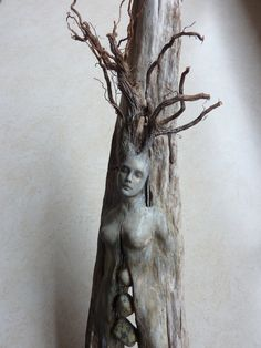 [Image #1 of Week: Oct 21st - Oct 25th]. This spirit tree woman with stones is really simplistic. But it's very poetic, a woman and her spirit becoming a part of the wood, and sad because she can't reach the heart of anyone else.