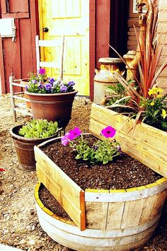 diy garden #planter #outdoor - cut a barrel into tiers for separate planter areas. #springintothedream