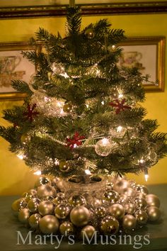 Combine a small artificial tree with a yard sale ornament wreath!
