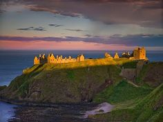 Sunset at Dunnottar Castle in Scotland.