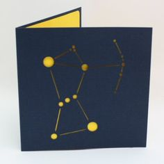 This a paper cut card  - the constellation Orion cut from 80lb midnight blue card with a vibrant yellow liner...