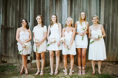 Bridesmaids in mix and match white dresses  Photography by lovekatieandsarah.com