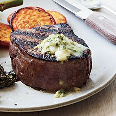 Pan-Seared Steak with Chive-Horseradish Butter - Top tender filet mignon with a chive-horseradish butter for an indulgent, 4-ingredient recipe that comes in at only 220 calories per serving. Serve with roasted, thinly-sliced sweet potatoes and Broccolini.