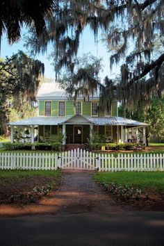 """A 19th Century Florida Cracker home ~  a still popular style of woodframe home characterized by metal roofs, raised floors, large porch areas (often wrapping around the entire home) & straight central hallways from the front to the back of the home (sometimes called """"dog run"""" or """"shotgun"""" style)."""