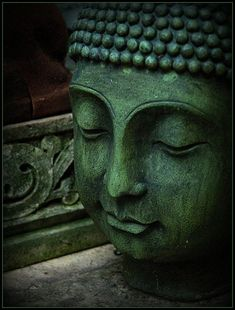 Green statue of Buddha