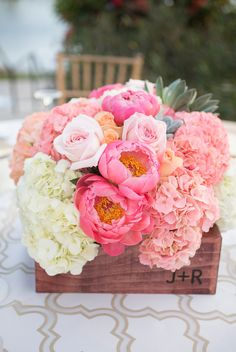Pink peony, hydrangea, and succulent centerpiece- complete with bride and groom initials on the wooden box!