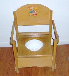 Vintage wooden toddler potty chair.