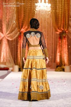 Saris and Things gold black lengha choli with cut out blouse