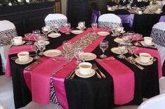 Pink and zebra wedding table setting