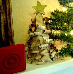I love the curly paper on this Recycled Ruffled Book Page Tree! This book craft is perfect for your Christmas table.