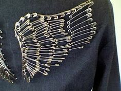 Safety pins wings