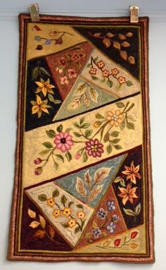 Hooked rug in a crazy quilt fashion