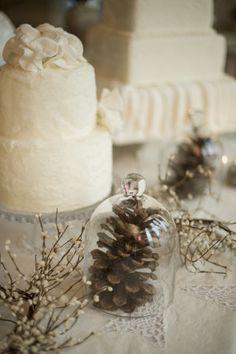 Pine cones a pretty and inexpensive way to incorporate the winter season into your decor. #winterweddings #weddingdecor #weddings