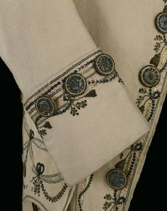 Detail of Gentleman's Frockcoat- 1770-1779, England. Wool and silk, hand woven and hand sewn, silver, gold. #Neoclassical #motifs