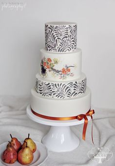 I wanted to create a cake that would be simple and clean, yet modern, stylish and stunning in it's own right. The cake is hand painted with a busy gray pattern and accented with delicate orange flowers in a watercolor style. I am loving the combination color scheme of orange and gray for Summer 2013 weddings!  -http://www.facebook.com/TLBCakes