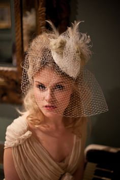 Beautiful birdcage and feather wedding veil by @HT Headwear
