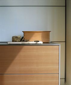 Just love this. bulthaup Swiss pear slim slim slim stainless steel worktop and sides. Also like the opaque glass back panels. Could be a sideboard, and not a kitchen it is so beautiful. From bulthaup Winchester