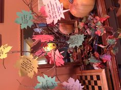 """""""Thankful"""" tree for Thanksgiving!  Write what you're most thankful for on cardstock leaves and hang them on limbs arranged in a vase."""