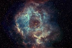 The Rosette Nebula is in the Monoceros region of the Milky Way Galaxy. The cluster and nebula lie at a distance of some 5,200 light-years from Earth and measure roughly 130 light years in diameter. The radiation from the young stars excite the atoms in the nebula, causing them to emit radiation themselves producing the emission nebula we see.