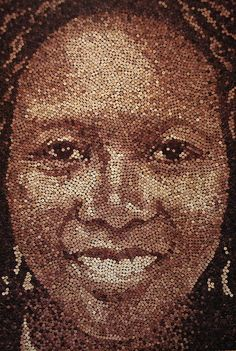 """Artist Scott Gunderson creates amazing, lifelike portraits out of recycled wine corks. This is titled """"Grace""""  with over 9000 corks,all stained naturally by wine, no paint."""