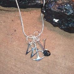 Hand made jewelry using WV Coal. WV charms with a Sterling Silver Pick & Shovel charm - REAL WV Coal in the shovel. Find us on Facebook - West Virginia Coal Jewelry  by Carol Dameron www.wvcoaljewelry.com