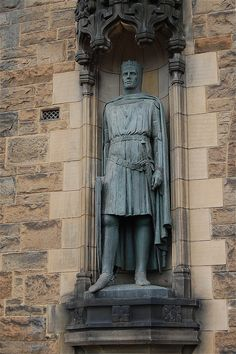 Sir Robert the Bruce (1274-1329). The statue is set in a niche on the left of the entrance to Edinburgh Castle.