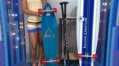 A PAIR OF SKATEBOARDS DESIGNED FOR STAND-UP PADDLING ON THE STREET, THESE TOP OF THE LINE LONGBOARD SKATEBOARDS EACH COME WITH AN ADJUSTABLE STICK. FROM KAHUNA CREATIONS. $626