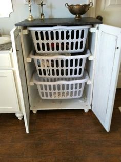 Want one of these for my laundry room, but open, and six hampers high, labeled.  Hello kids! How was school? Take your hamper downstairs, put your clothes away, then return it to the laundry room...  then you can have the homemade oreos and milk I prepared for you!