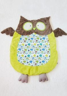 "Oh-so-soft and cuddly, this adorable green and brown owl will gently lull baby to sleep with a ribbed texture and wonderful vintage-inspired prints. Surface wash.         100% Polyester     Fill: 100% Polyester     44"" L x 30"" W"
