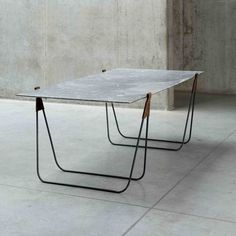 Ben Storms' trestle table out of marble, metal, and leather can be transformed into a full length mirror.