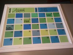 cheap frame, white poster board, paint swatches and scrapbook paper in various shades, and a dry erase marker. New classroom calendar!
