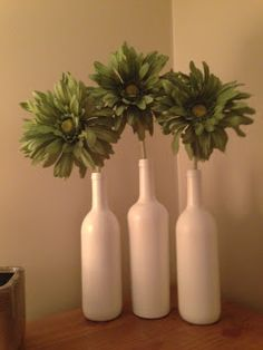 Wine Bottle Vases -maybe with burlap or brown stripes for bedroom.   Green or black for reunion?