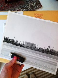 Great idea - use kinko's to enlarge a photo on their blueprint printer - costs around $4/print.  Mount on foam board ~ $7.