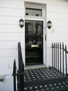 Black door, lanterns, tile
